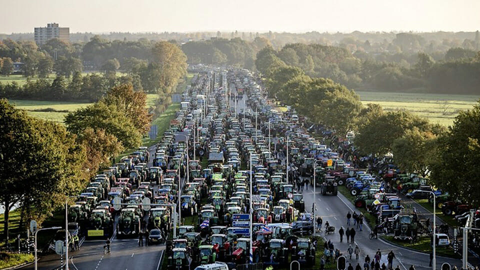WATCH: Dutch tractors blockade The Hague in protest against 'crippling' climate ruling