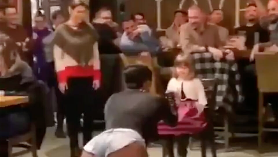 TikTok video shows drag queen performing lewd dance for little girl as room full of adults looks on