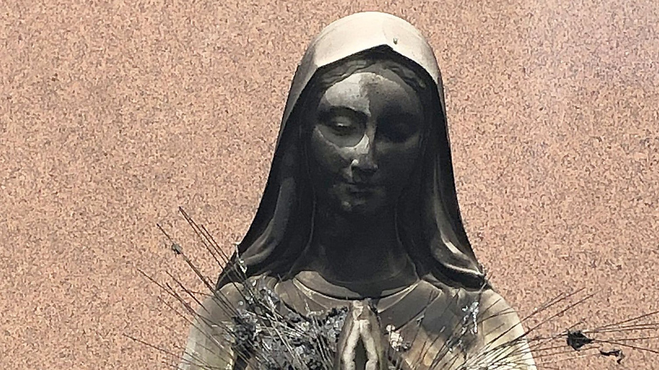 Statue of Mary set on fire as churches also burned in U.S.
